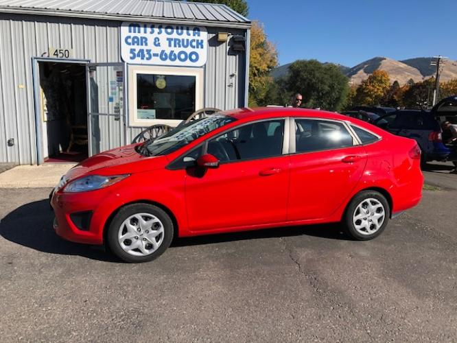 2013 Ford Fiesta SE Sedan (3FADP4BJ4DM) with an 1.6L L4 DOHC 16V engine, Automatic with Overdrive transmission, located at 450 N Russell, Missoula, MT, 59801, (406) 543-6600, 46.874496, -114.017433 - Photo #0