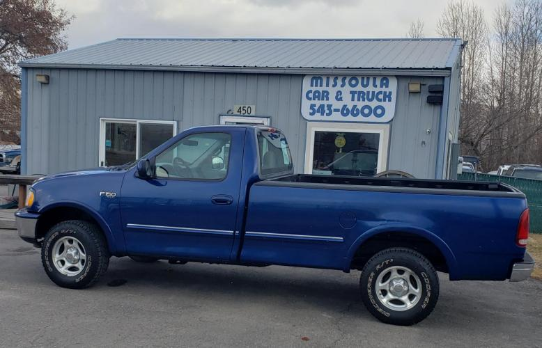 1997 Blue Ford F-150 Reg. Cab Long Bed 4WD (2FTDF1823VC) with an 4.2L V6 OHV 12V engine, 5 speed manual transmission, located at 450 N Russell, Missoula, MT, 59801, (406) 543-6600, 46.874496, -114.017433 - Photo #0