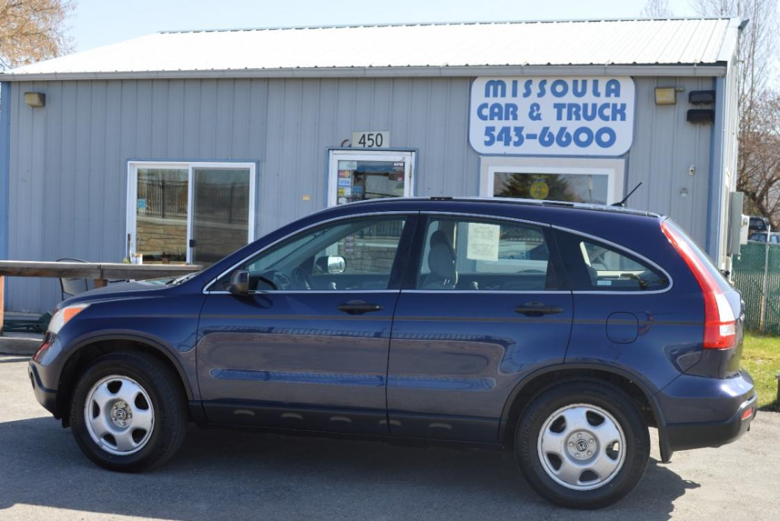 2009 Blue Honda CR-V LX 4WD 5-Speed AT (JHLRE48399C) with an 2.4L L4 DOHC 16V engine, 5-Speed Automatic transmission, located at 450 N Russell, Missoula, MT, 59801, (406) 543-6600, 46.874496, -114.017433 - Photo #0